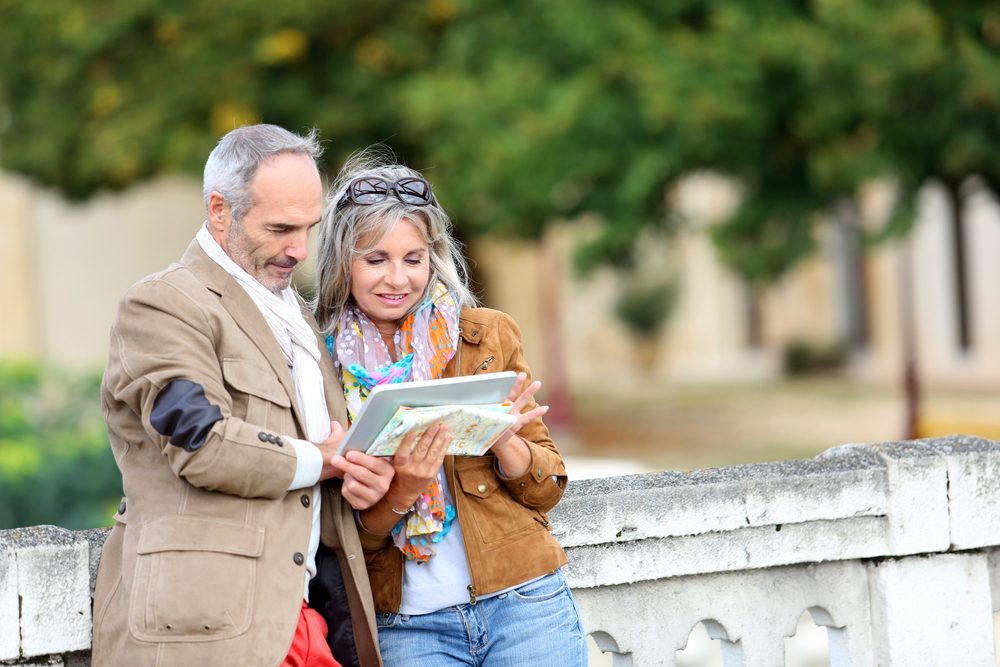 Senior couple of tourists on a trip